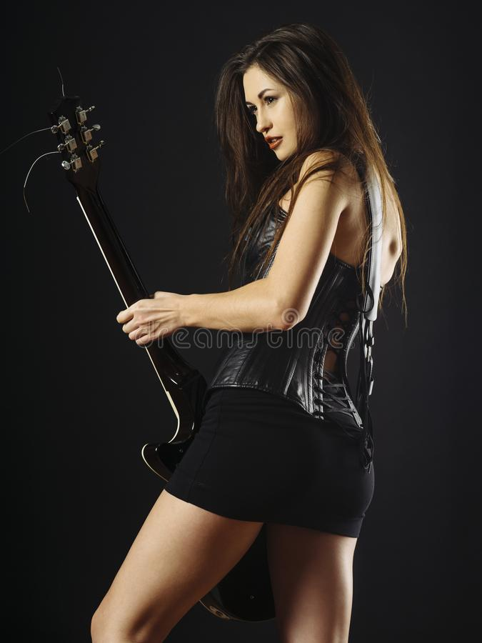 Download Woman Playing Electric Guitar Stock Image - Image of fashion, guitarist: 109215701