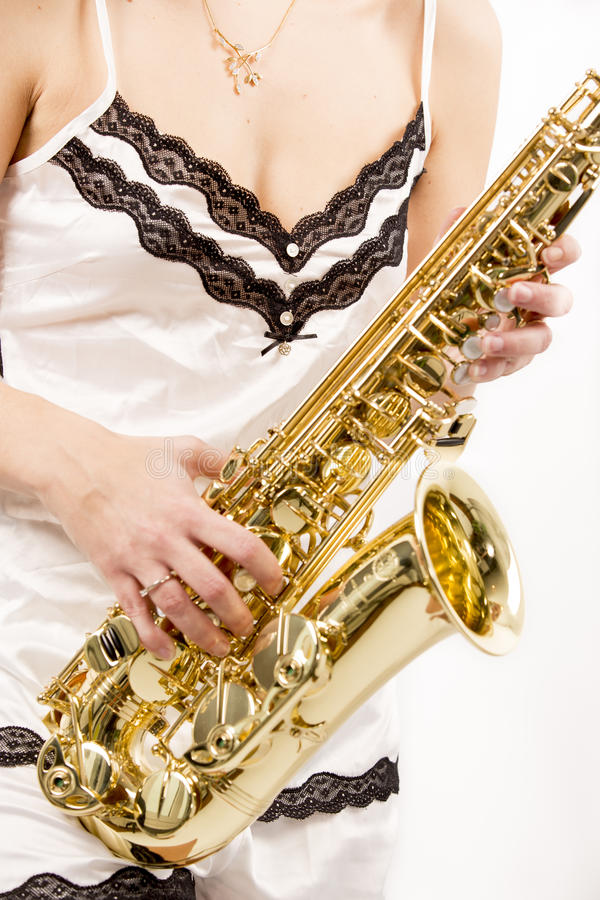 woman playing saxophone stock images
