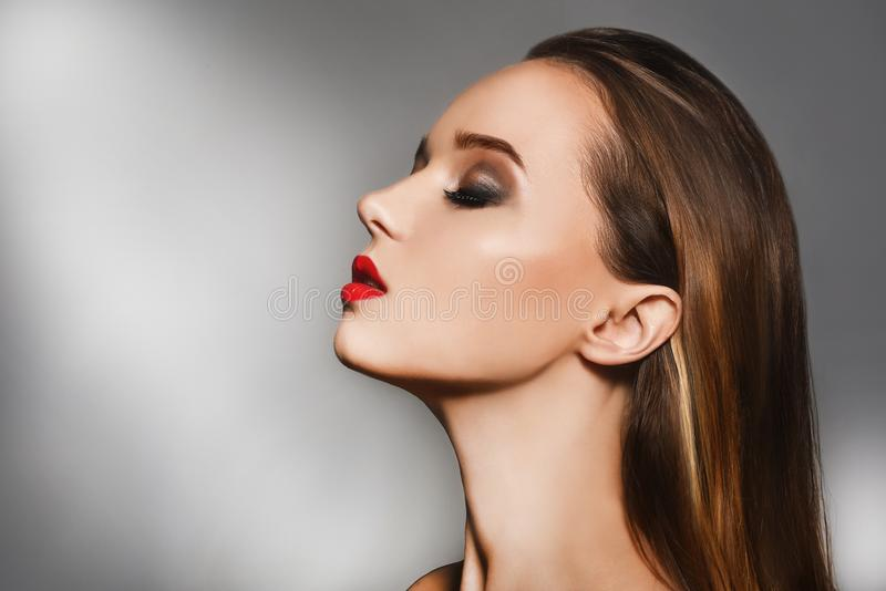 woman portrait with perfect makeup. Close up portrait of elegant luxurious woman. Bright make up, red lips. Beautiful royalty free stock images