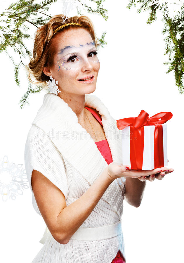 woman with present wrapped in white paper stock image
