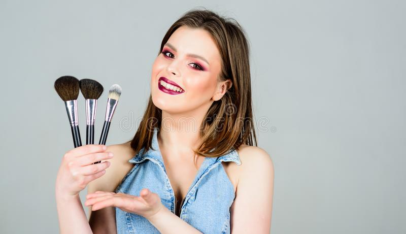 Sexy woman with professional make up brush. copy space. fashion makeup visage. beauty hairdresser salon. Lipstick and. Eyeshadow. sexuality. skincare cosmetics royalty free stock images