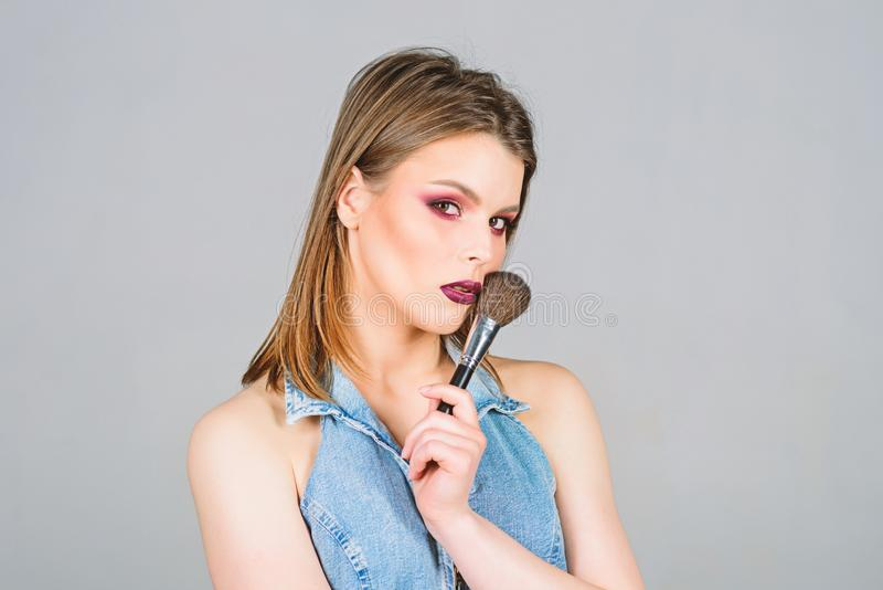 Sexy woman with professional make up brush. sexuality. skincare cosmetics. beauty hairdresser salon. Lipstick and. Eyeshadow. sensual woman with long hair stock image