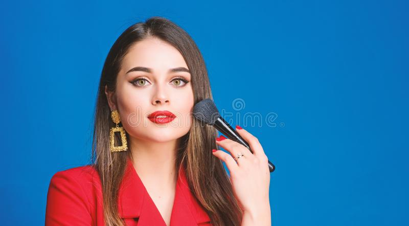 Sexy woman with professional makeup brush tool. beauty and fashion. hair beauty and hairdresser salon. jewelry earrings stock images