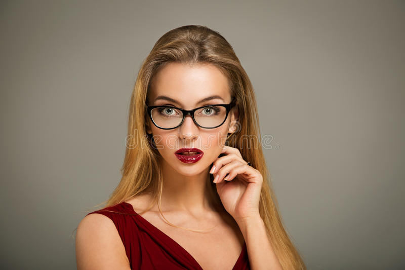 Woman in Red Dress and Glasses royalty free stock photos