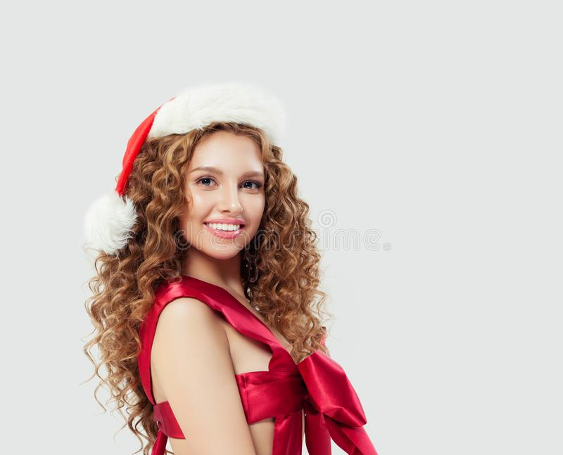 Sexy woman in red silky swimsuit and Santa hat on white, Christmas gift concept royalty free stock image