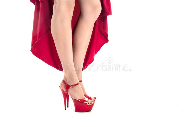 woman`s legs in red high heels stock image
