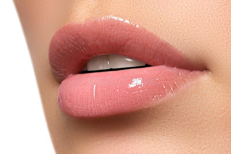 woman's lips. Beauty lips make-up. Beautiful make-up. Sensual open mouth. Lipstick and lip gloss. Natural full lips royalty free stock images