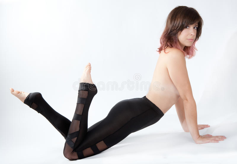 Woman in Shiny Leggings royalty free stock images