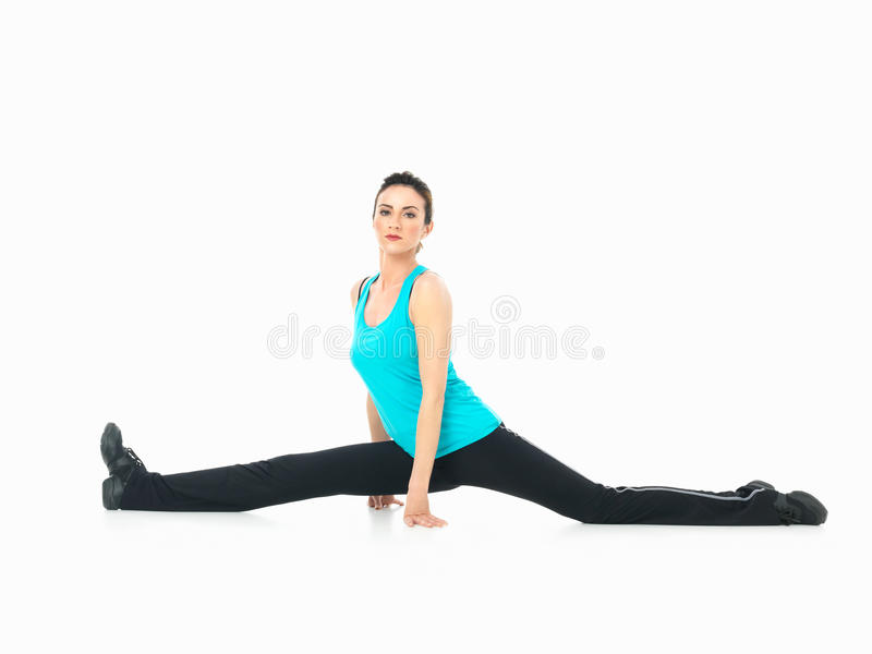 woman showing fitness moves, white background stock image