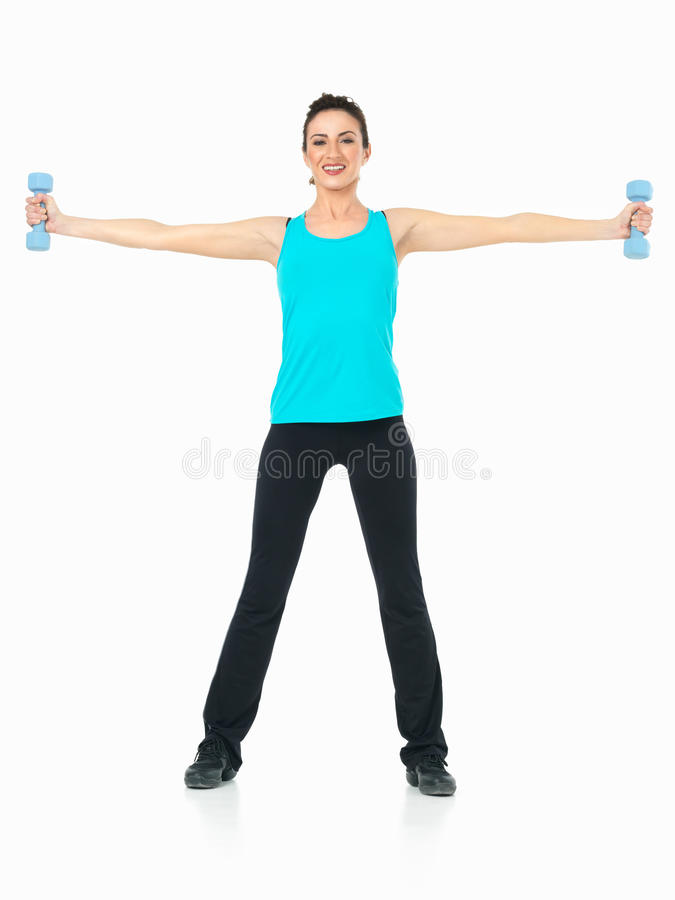 woman showing fitness moves, white background stock photography