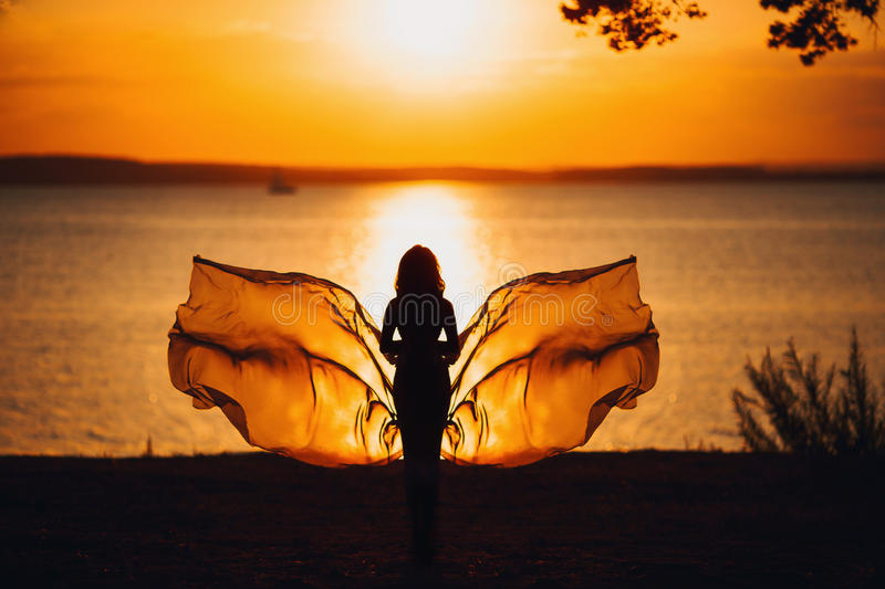 Woman Silhouette over Red Sunset Sky, Sensual stock photo