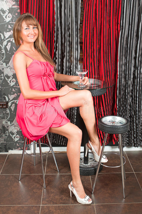 Download Woman Sits In Bar With Martini Stock Image - Image: 22679167