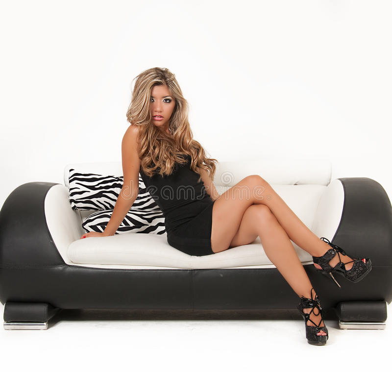 Woman Sitting On Sofa Royalty Free Stock Photography
