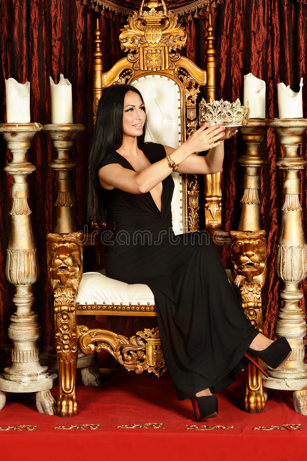 Woman sitting on throne stock photo Image of beautiful