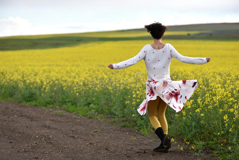 woman in skirt dancing in the nature stock photography