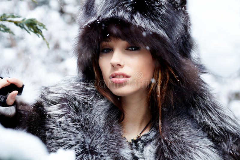 Woman In Snowy Winter Outdoors Stock Photo