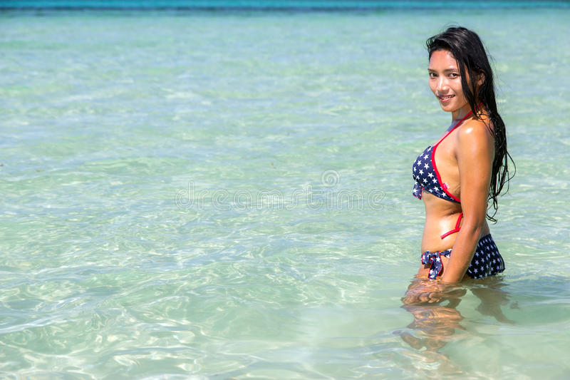 woman stands in a swimsuit at a clear sea royalty free stock photo