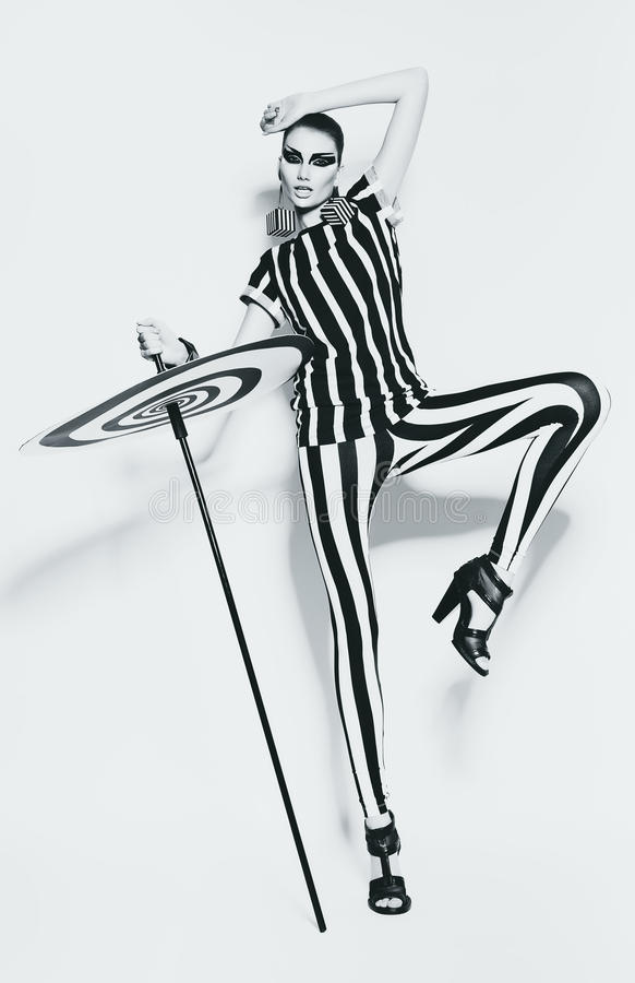 Woman in striped leggings and striped top. In studio royalty free stock photography