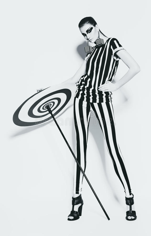 Woman in striped leggings and top. In studio royalty free stock photography