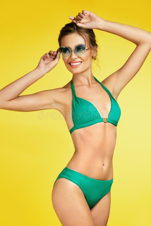 Woman In Swimsuit And Sunglasses. royalty free stock photography