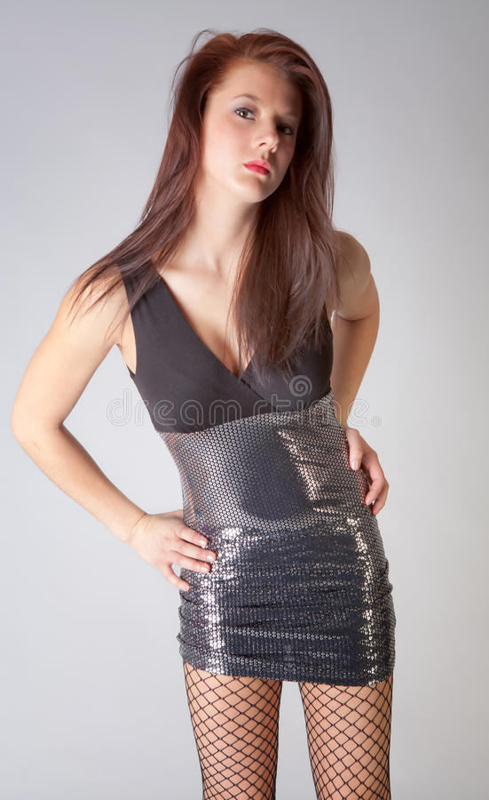 Woman in Tight Dress with Fishnet Pantyhose royalty free stock photo