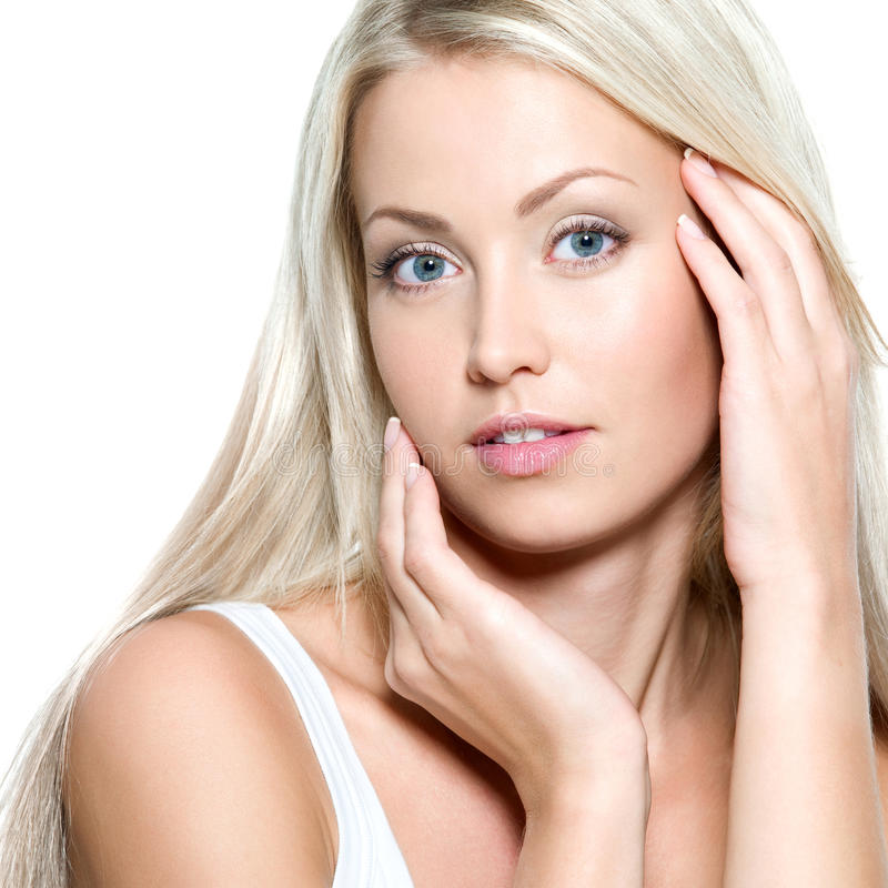 woman touching her fresh face stock photos
