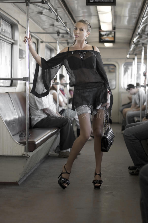 Woman in the train. Beautiful retro stylized photo of a woman in the train. Fashion art photo stock images