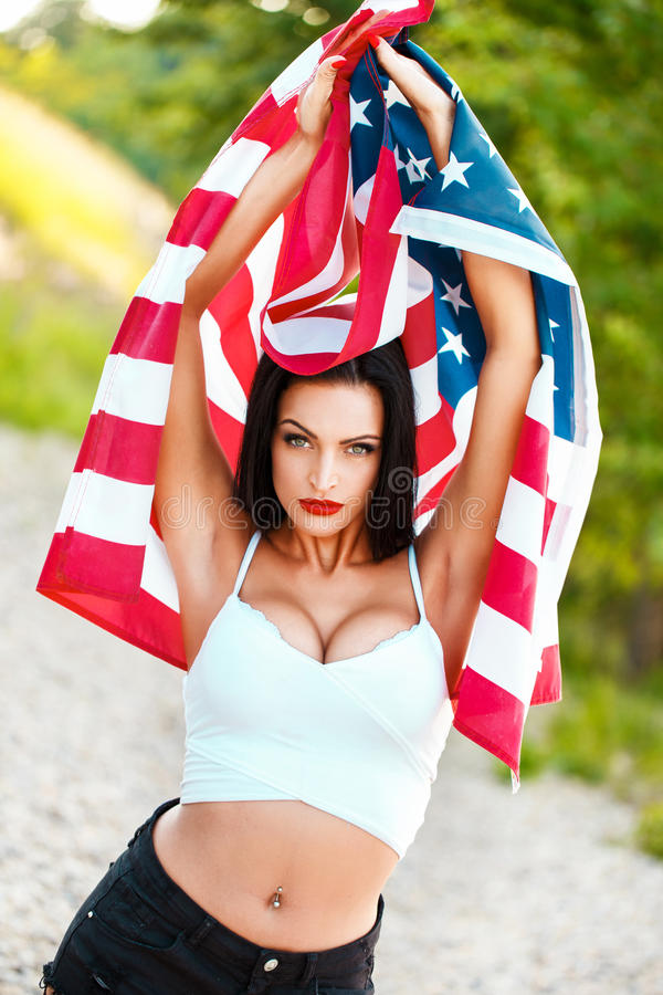 Woman with usa flag outdoor. Star spangled banner, 4th of july, independence day stock image