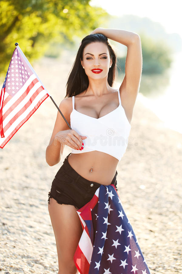 Woman with usa flags outdoor. Star spangled banner, 4th july, independence day royalty free stock photo