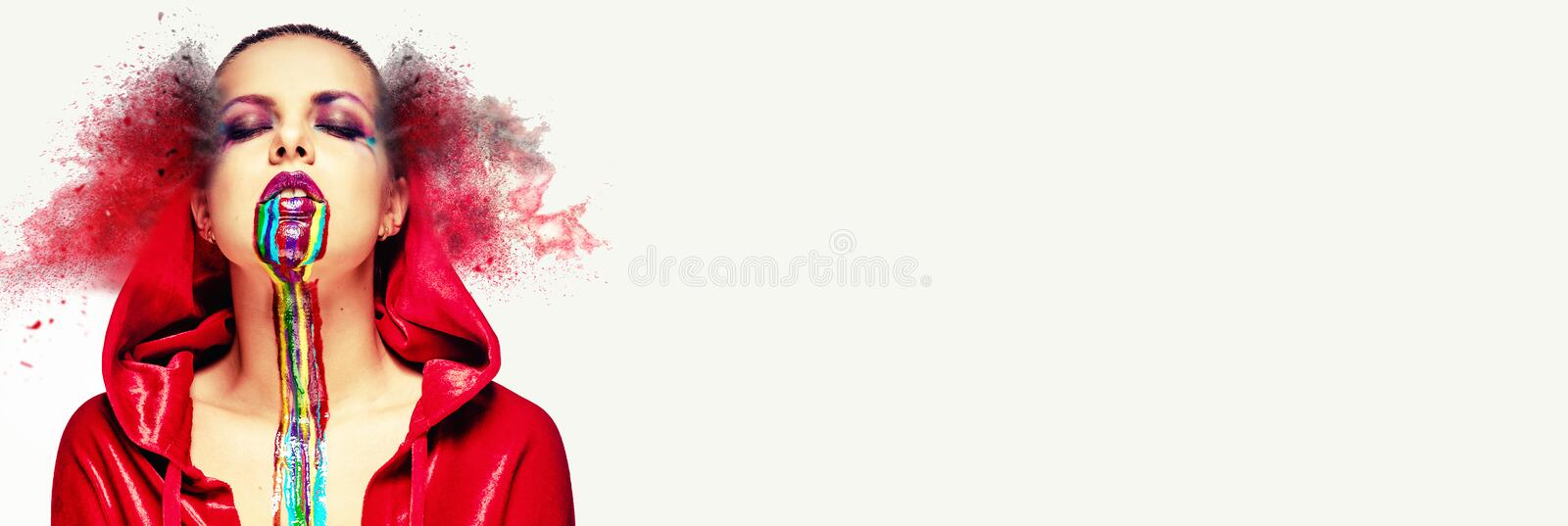 Sexy woman wear red cloak creative bright face make-up body art paint rainbow colors paint flowing down. Digitally generated image royalty free stock images