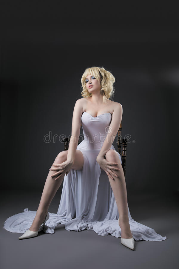 woman in white fashion dress sit on chair royalty free stock photos
