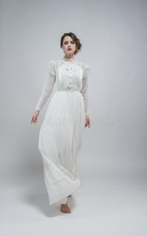 woman in white long retro dress stock image