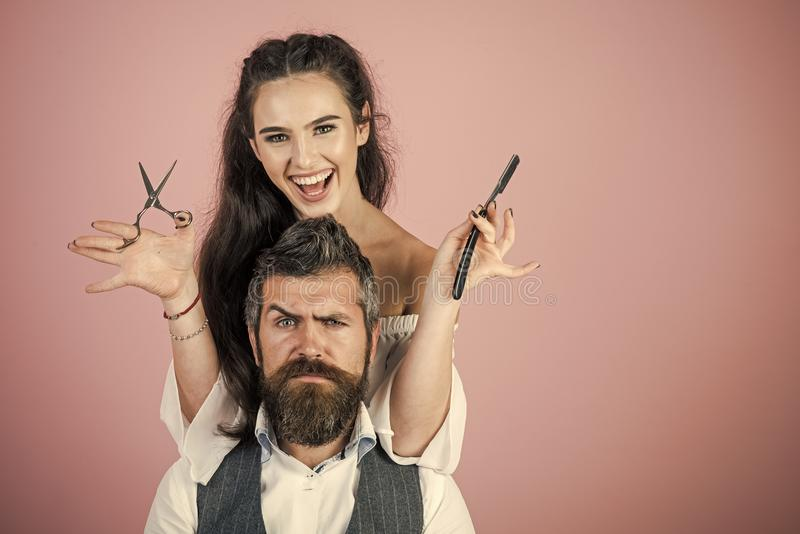 woman. Woman with razor, scissors cut hair of man. stock image