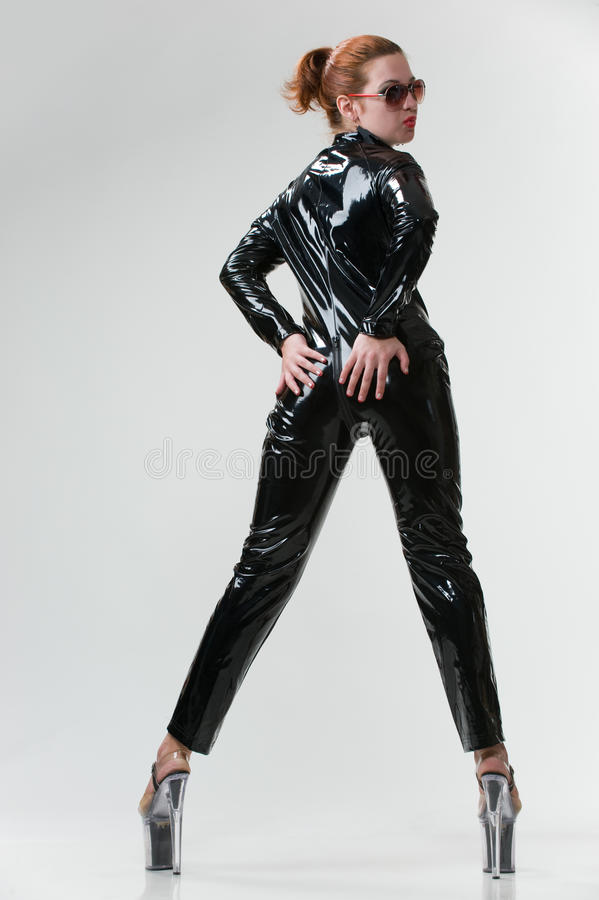 Download Wouman In Latex Overalls In Studio Stock Image - Image: 18879455
