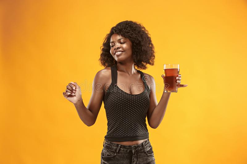 young afro woman drinking beer, not isolated on white background stock images