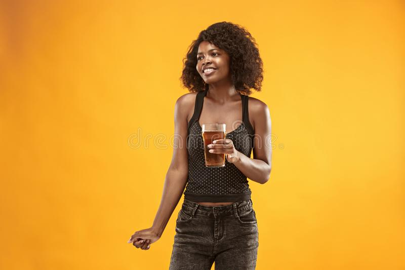 young afro woman drinking beer, not isolated on white background royalty free stock image