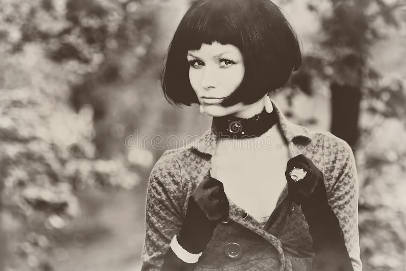 Young beautiful pretty woman girl lady model with black bob hair hairdo vintage retro sepia old aged. Young beautiful pretty woman girl lady seductive model with royalty free stock photos