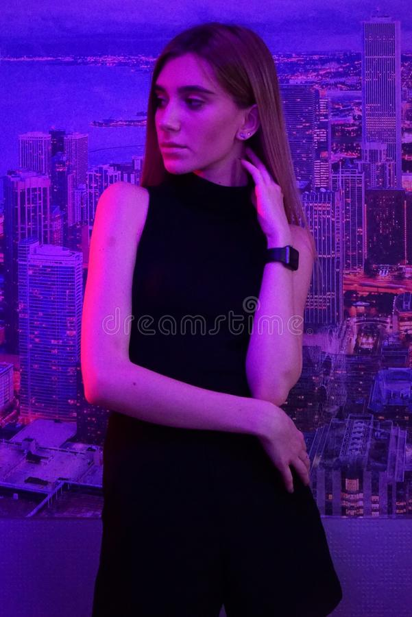 young beauty woman posing over night city dramatic pink neon and city background royalty free stock photos