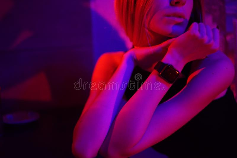 Young beauty woman posing over night city dramatic red and blue neon background. Young beauty woman posing over night city dramatic red and blue neon and city stock image
