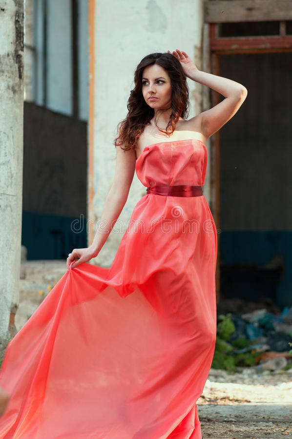 young beauty woman red dress in smoke royalty free stock photography