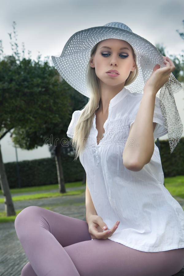 young blond girl in hat stock photography