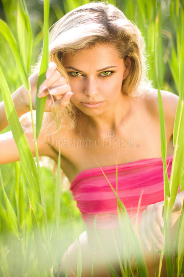 Download Young Blond Woman In Green Grass Stock Image - Image: 23249899