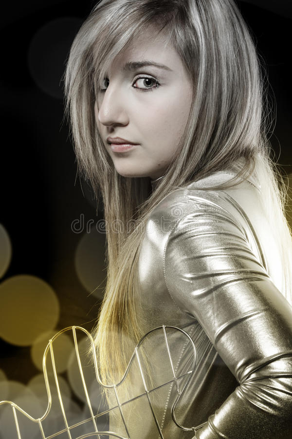 young blonde in silver dress, futuristic image royalty free stock photo