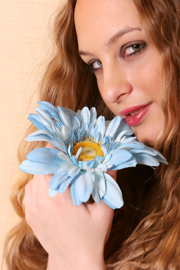 young blonde woman with flower stock photos
