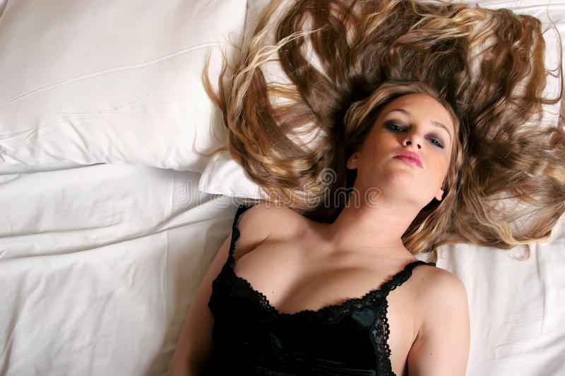 young blonde woman with long hair stock photography