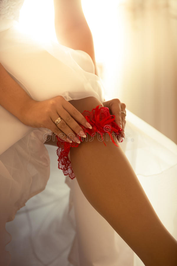young bride putting on nylon stockings royalty free stock photo
