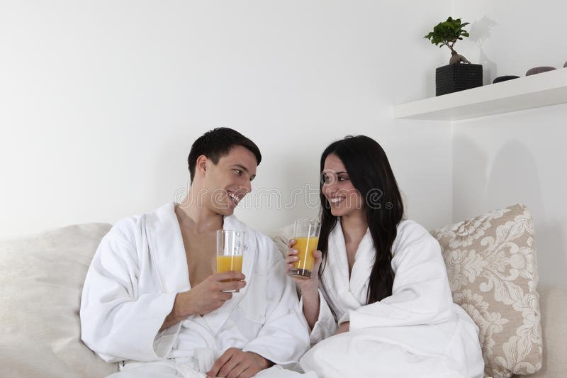 Download Young Couple In The Morning Having Breakfast Stock Photo - Image of lying, happy: 15945900