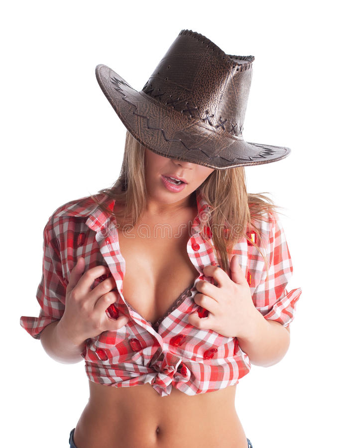 young cowgirl put hands on breast stock photography