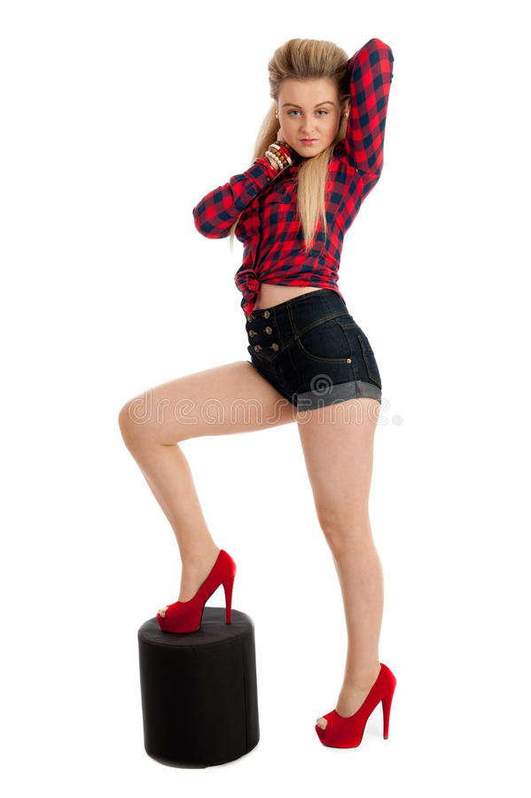 Young Female In Shorts And Shirt Royalty Free Stock Photo