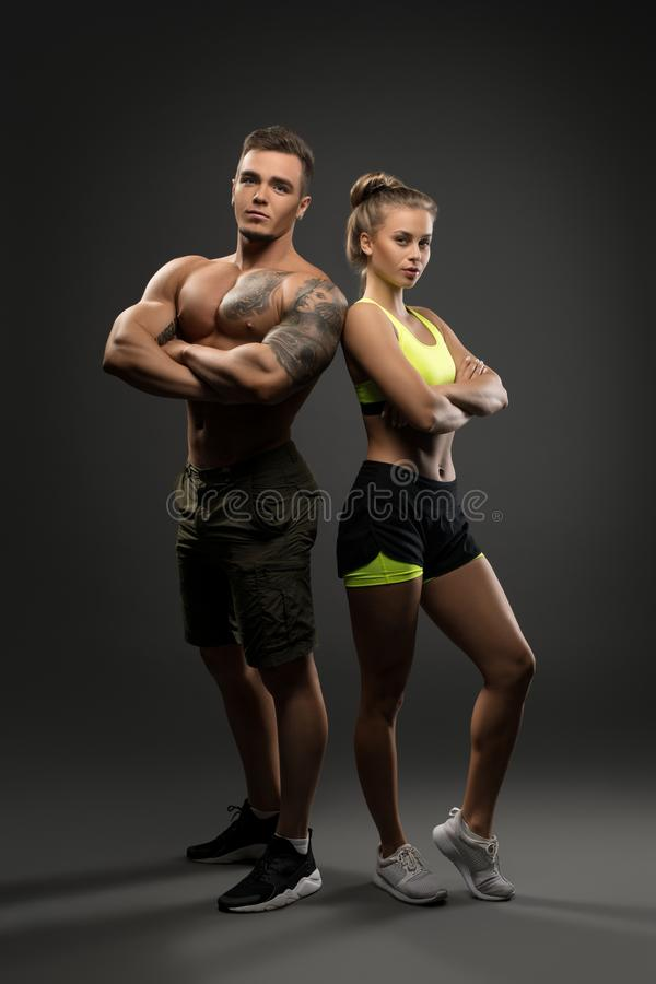young fitness couple shot on gray background stock photo